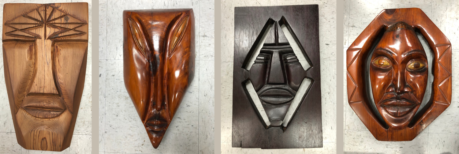 Carved masks by Featured Artist, Homer Johnson