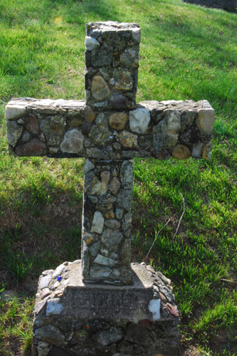 """The most well known and loved of Christian symbols is the simple cross. It is a sign of salvation and hope and Christians believe that it has the power to defend them from evil. It represents Christ's victory over death and sin. The handmade nature of this cross, using local cobbles, is unusual. At the bottom is etched """"Mother."""""""