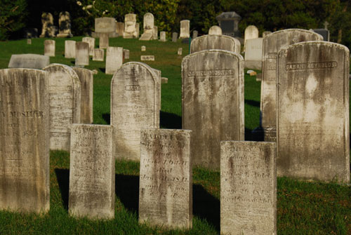 The function of the stone was twofold: first, to identify the plot of land where someone was buried and, second, to give basic information—name of the departed, date and place of birth, name of spouse if any, date and place of death, cause of death, occupation. Next came the epitaph which presented a moral quotation meant to influence those left behind. Lastly, the shape, design and carvings were created to impress those viewing the final resting place.
