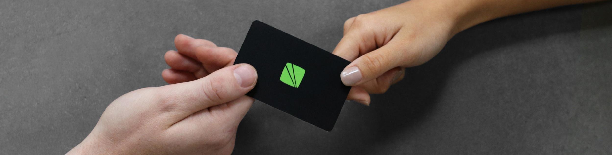 hands passing fusian card