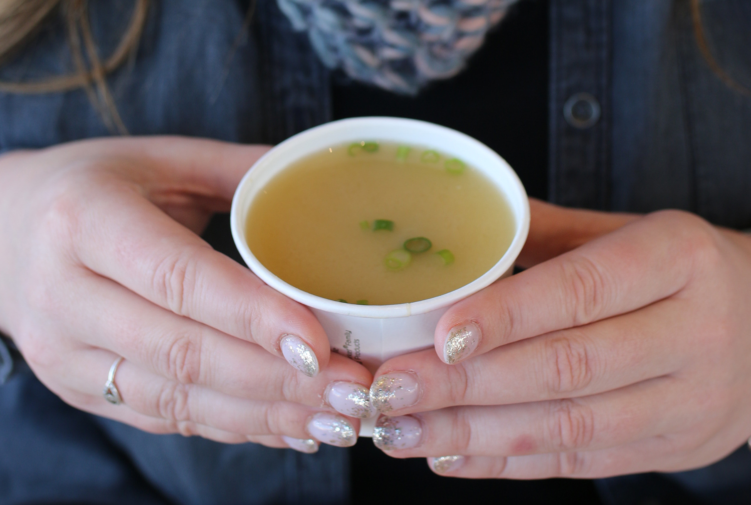 hands holding soup