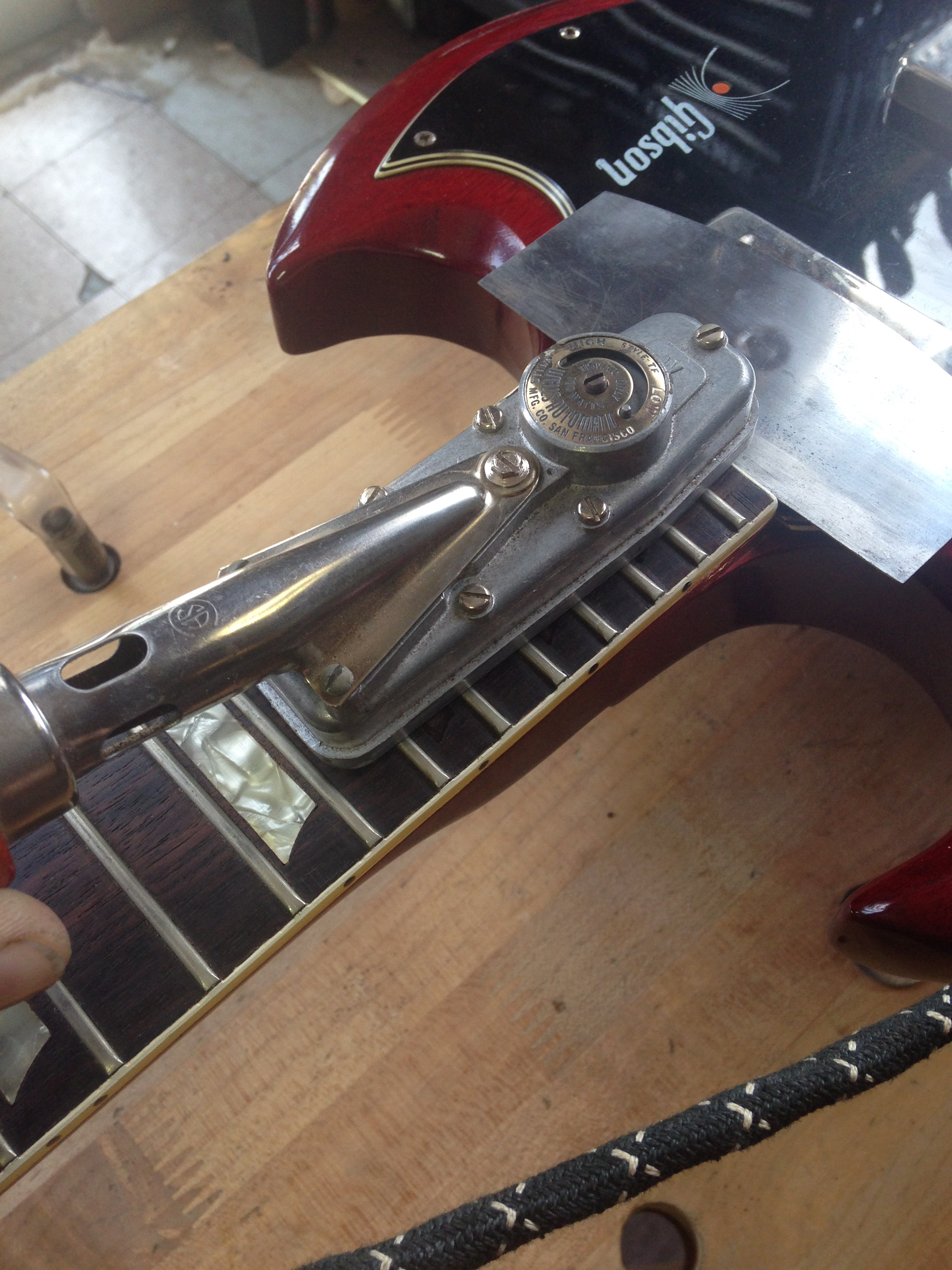 - Once the inlays are out and the bindings in this area are loose I use a small iron to heat up this part of the fingerboard.