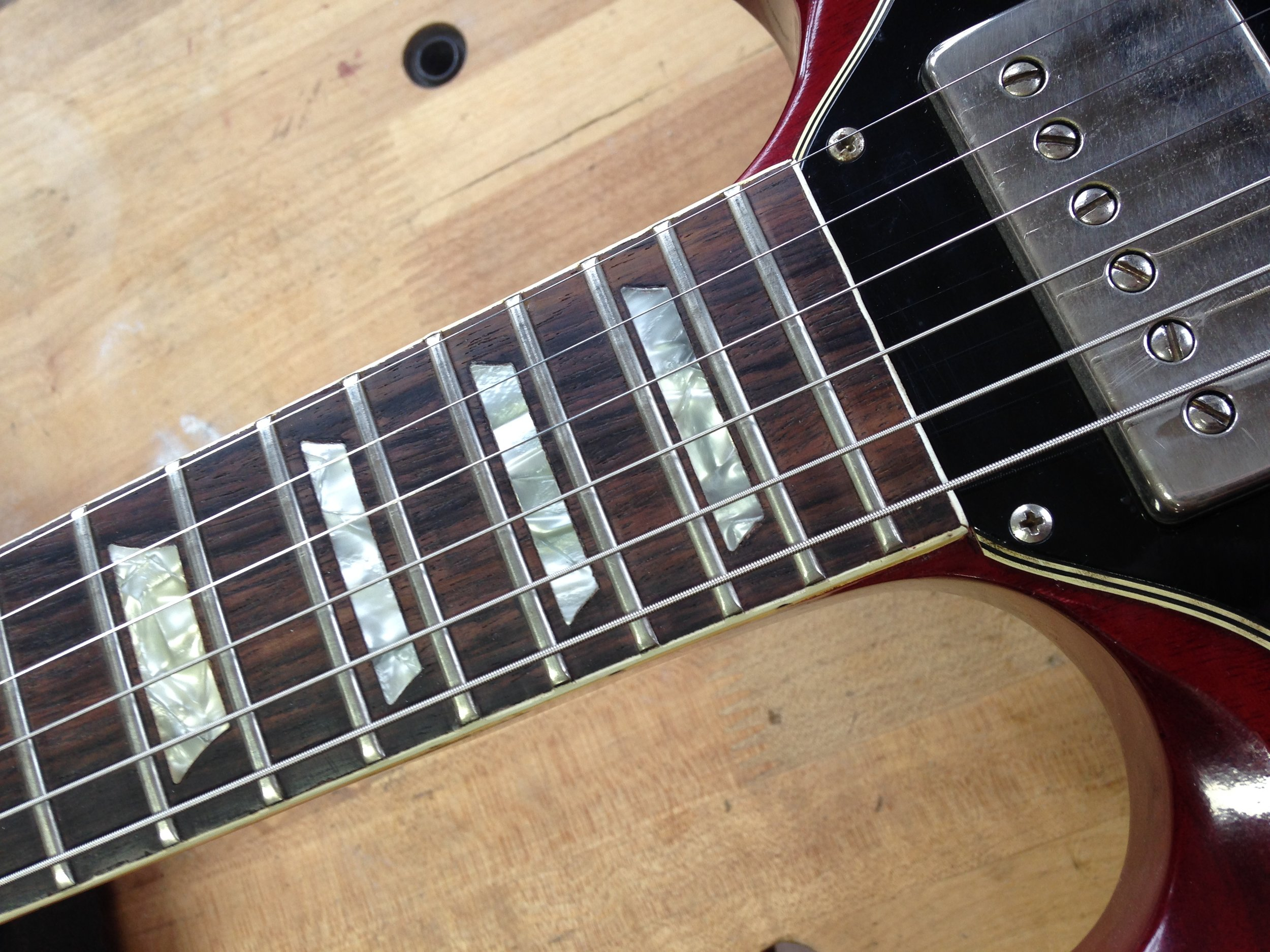 - Once the section of the fingerboard, inlays and binding are re-installed the repair is invisible. Now this old guitar has a great working truss rod!