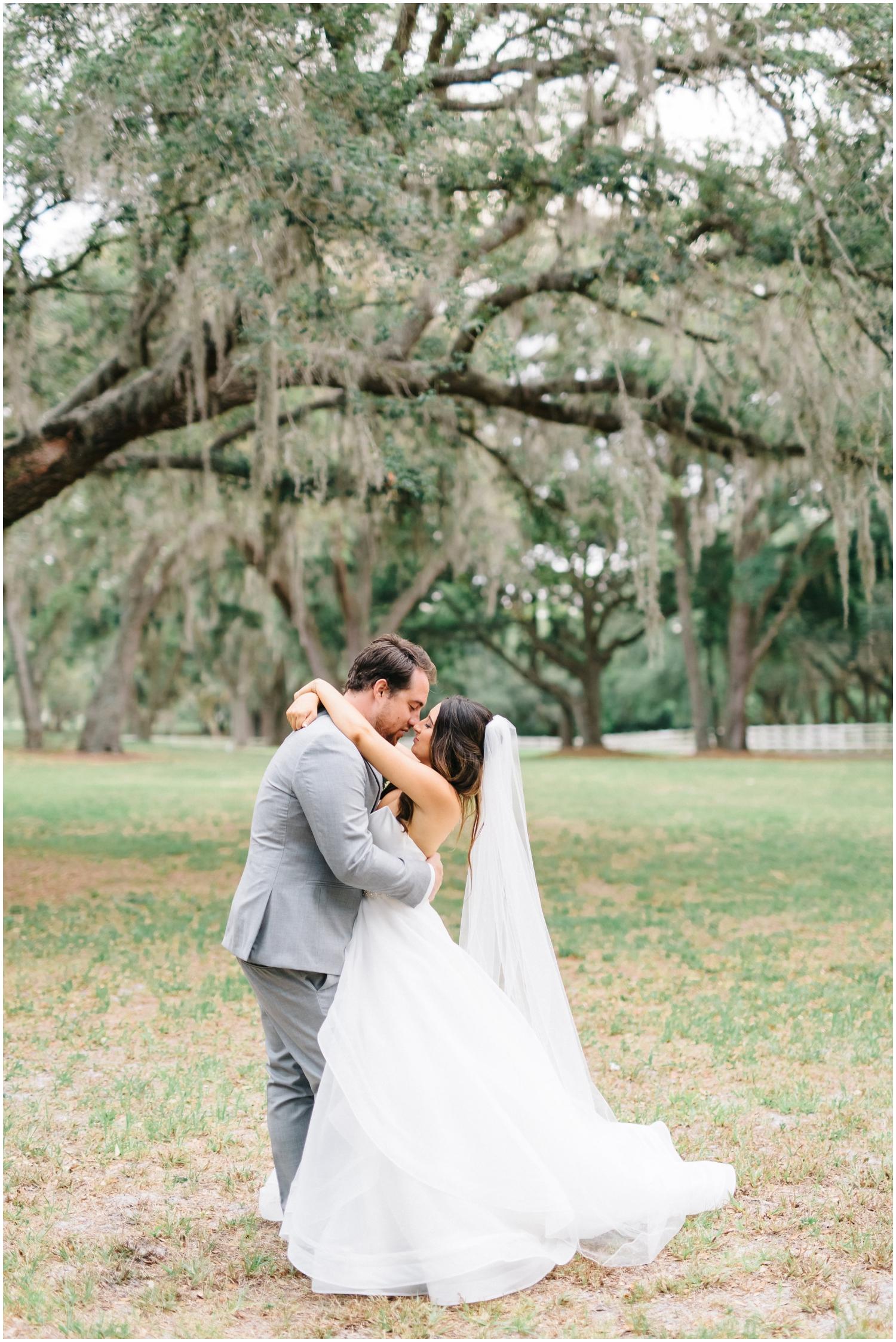 Bride and groom kiss at their Florida wedding