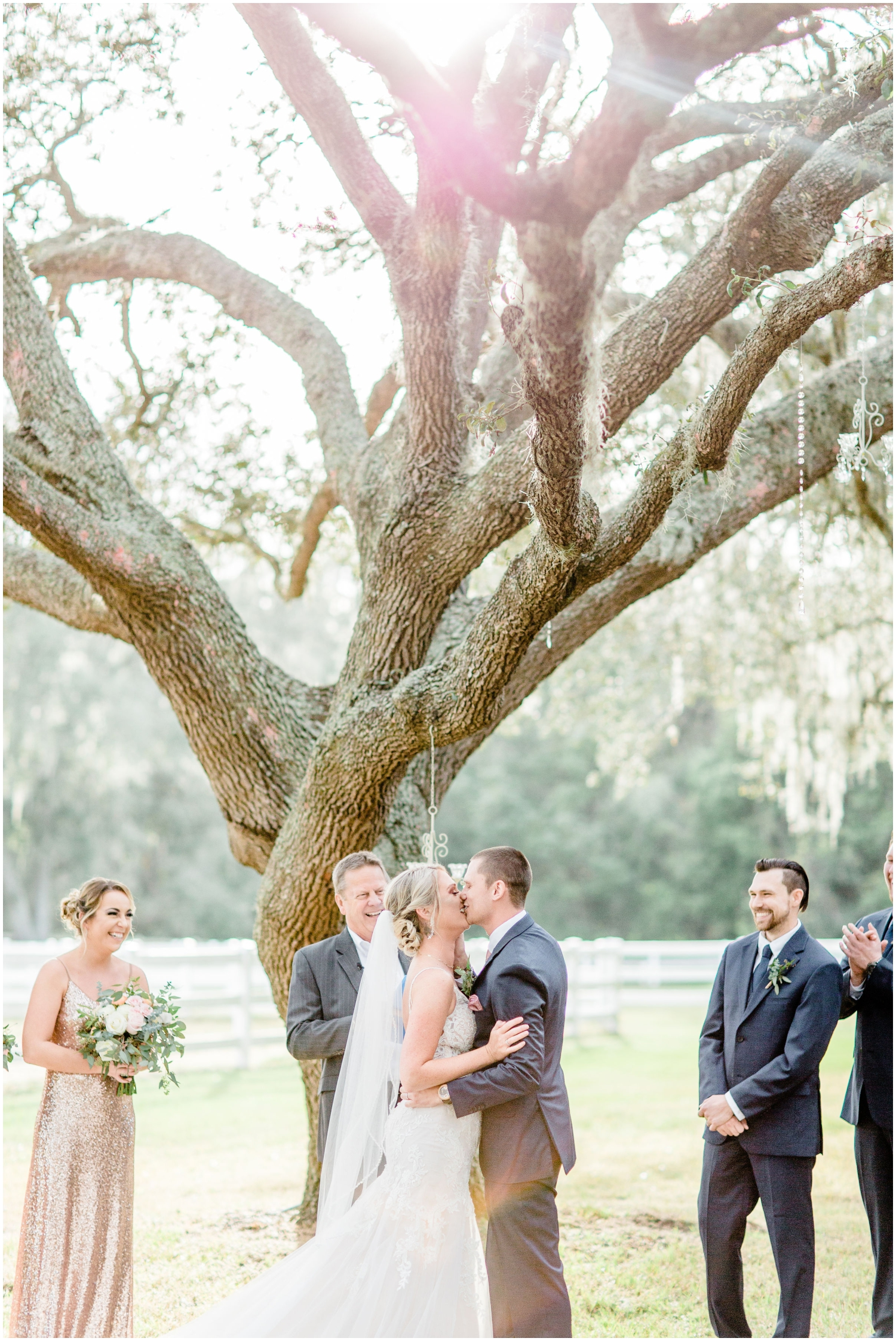 Bride and groom kiss during their outdoor wedding