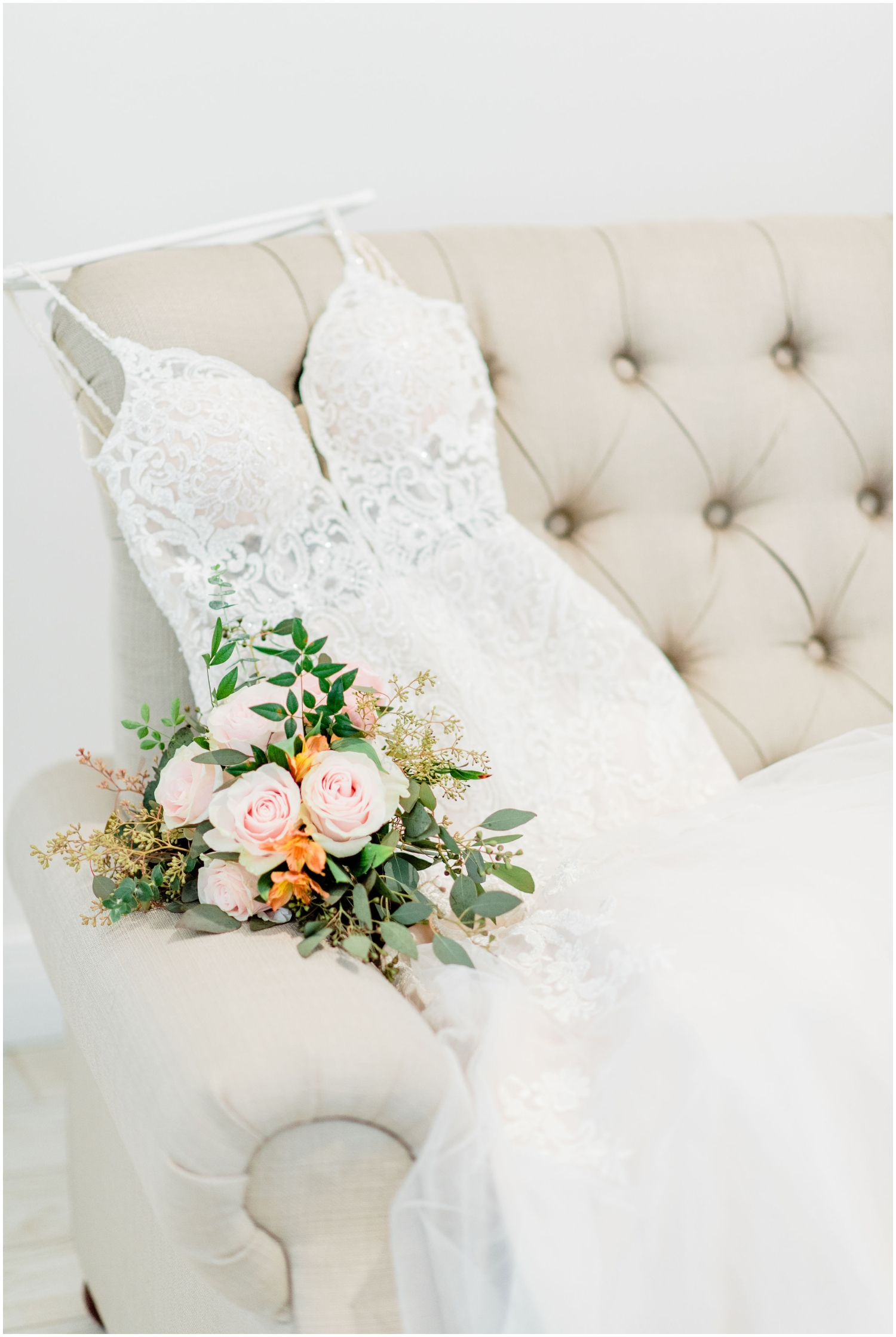 Bride's wedding gown and bouquet