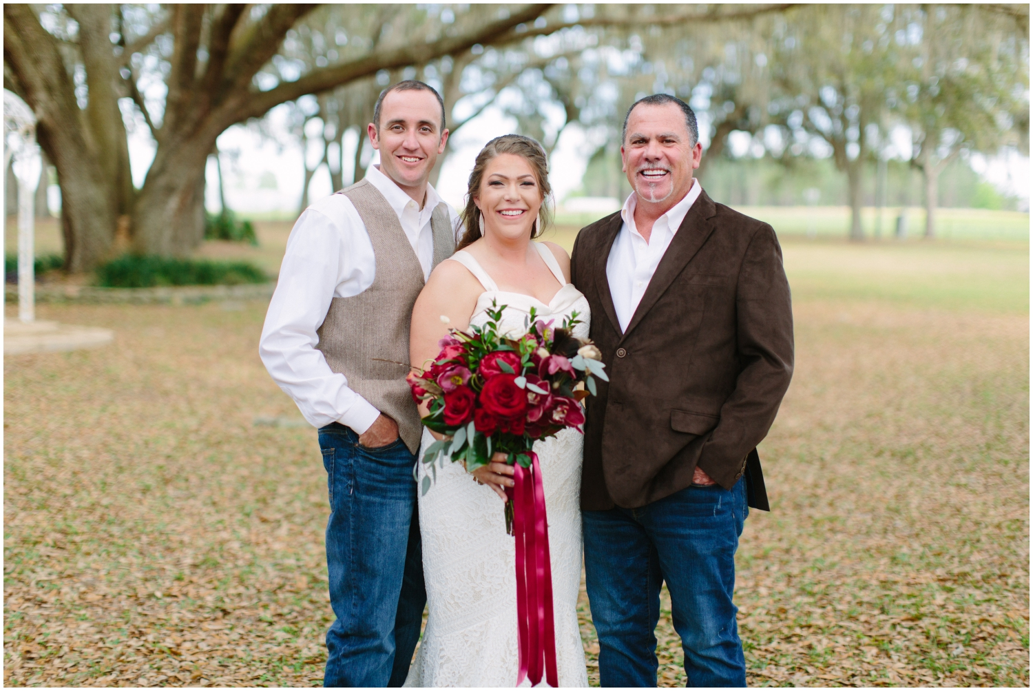 Bride with the groom and father