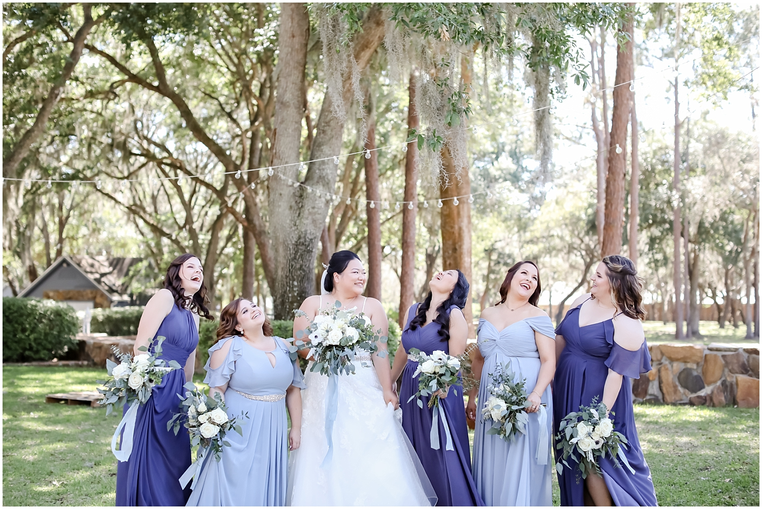 bride with her bridesmaids holding their wedding bouquets