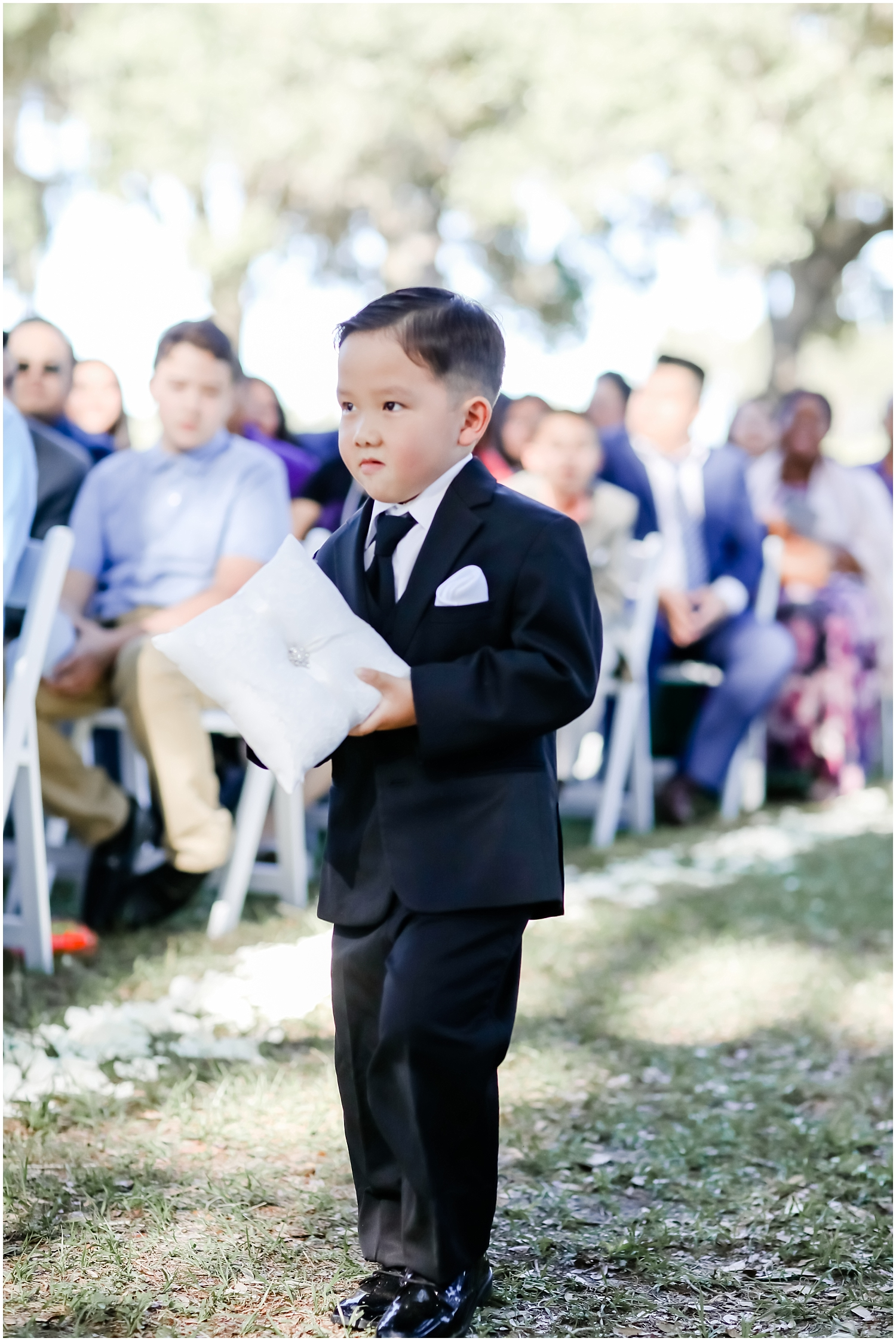 ring bearer walking down the aisle