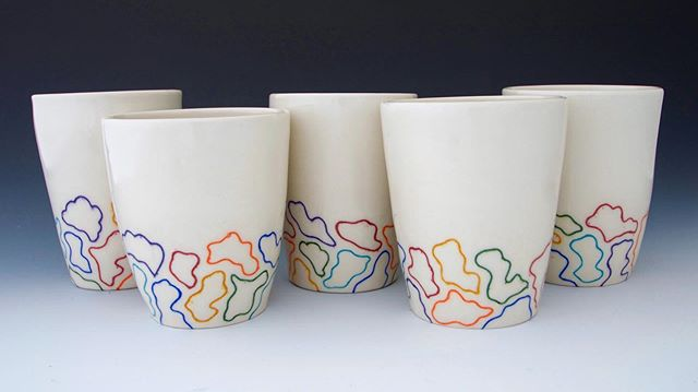 I'm currently in the process of making more of these rainbow cups! I will have them available for sale later this month at my next pop-up shop 🌈 🌈🌈🌈🌈🌈 Oct. 18th - 19th, Screw Factory Fall Art Show, Lakewood @screwfactoryart • • • • #ragpottery #pottersofinstagram #pottery  #ceramics #makersgonnamake #handmade #handcrafted #artisan #porcelain #handmadepottery #functionalpottery #ohiocreative #ohiomade #handmadeinohio #amaco #amacounderglaze #shopsmall #mishima #rainbow #handmadecup #ceramiccup #ceramictumbler #porcelaincup #screwfactory