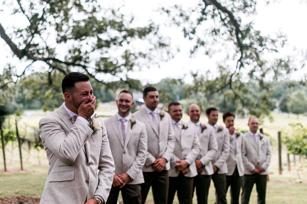 7 groom-reaction-black-barn-vineyard-and-winery-outdoor-wedding.jpg