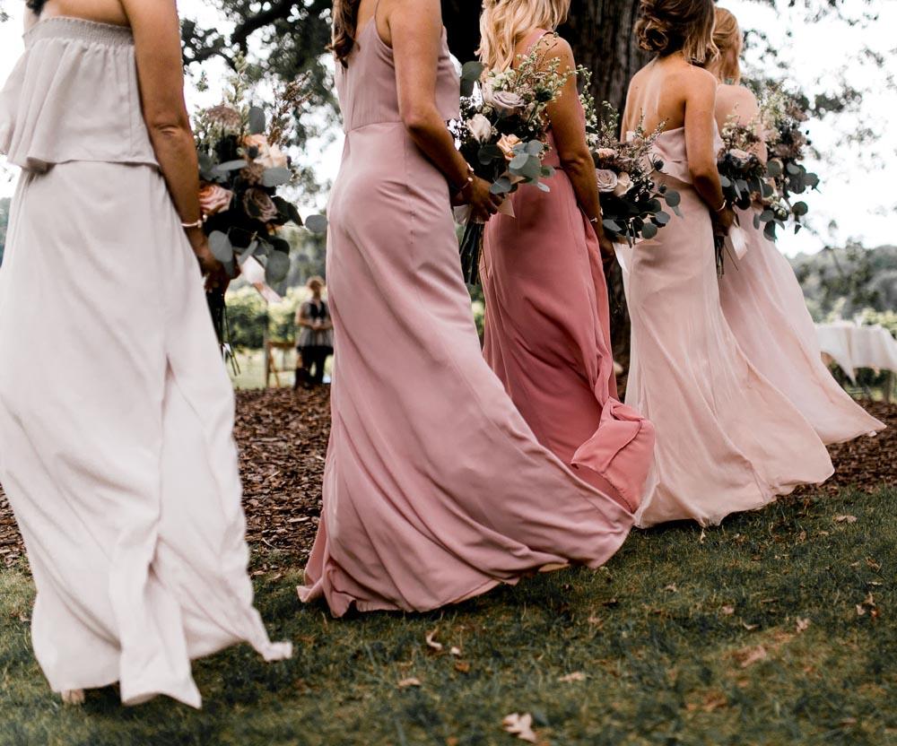 8 black-barn-vineyard-and-winery-bridesmaids-pink-michigan.jpg
