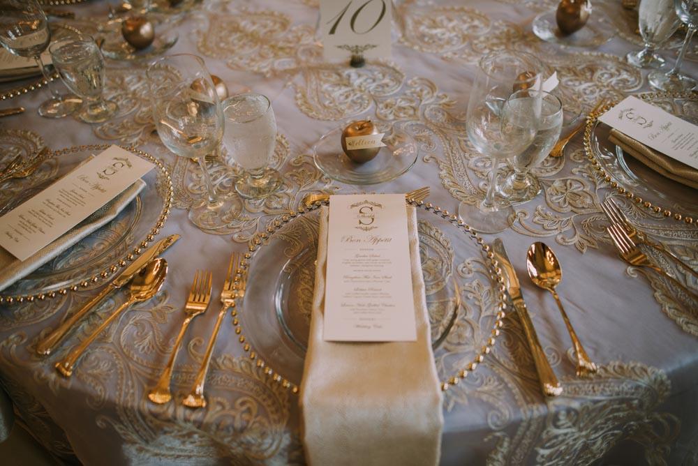 24 romantic-wedding-style-black-tie-wedding-place-setting-gold-luxury.jpg