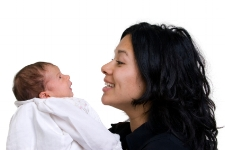 Mom looking at baby; speech and language devlopmental milestones at Canto Speech Therapy Online
