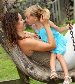 Mom talking to little girl in tree; vocabulary development at Canto Speech Therapy Online