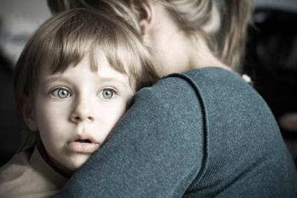 Mom hugging boy with speech apraxia at Canto Speech Therapy Online