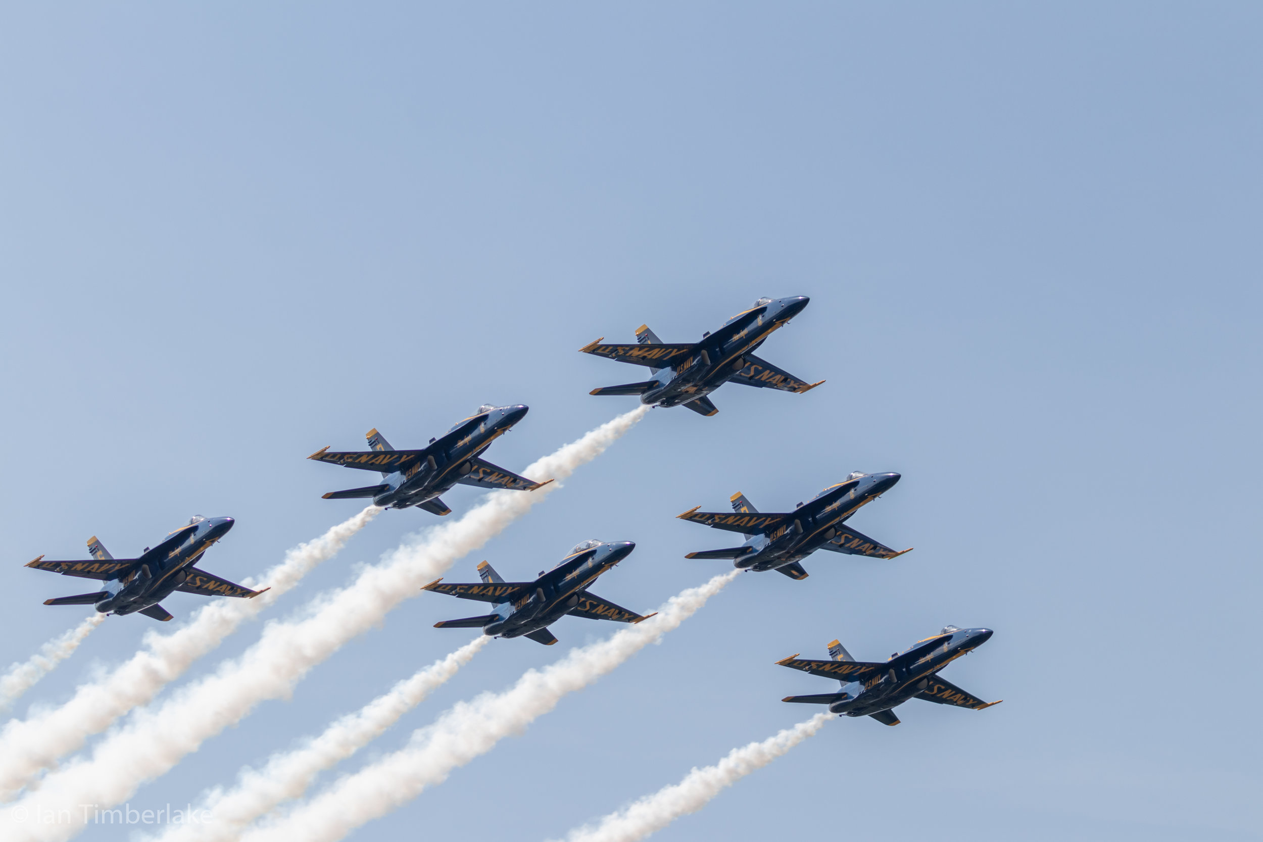 United States Navy Blue Angels in delta formation flying over the United States Naval Academy Navy-Marine Corps Memorial Stadium during the graduation and commissioning ceremony. Taken at 100mm, 1/800th sec, f/4.5, ISO 100.