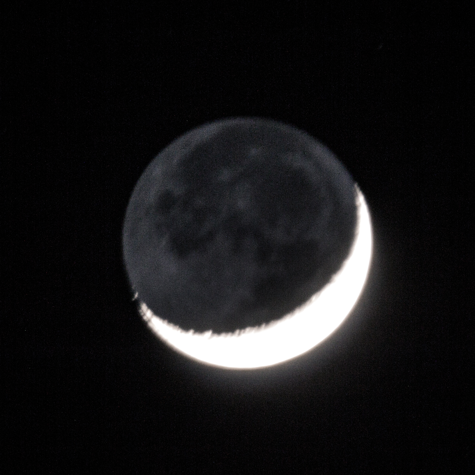 Taken the same night as the above photo. This is an exposure for the shaded side of the moon.