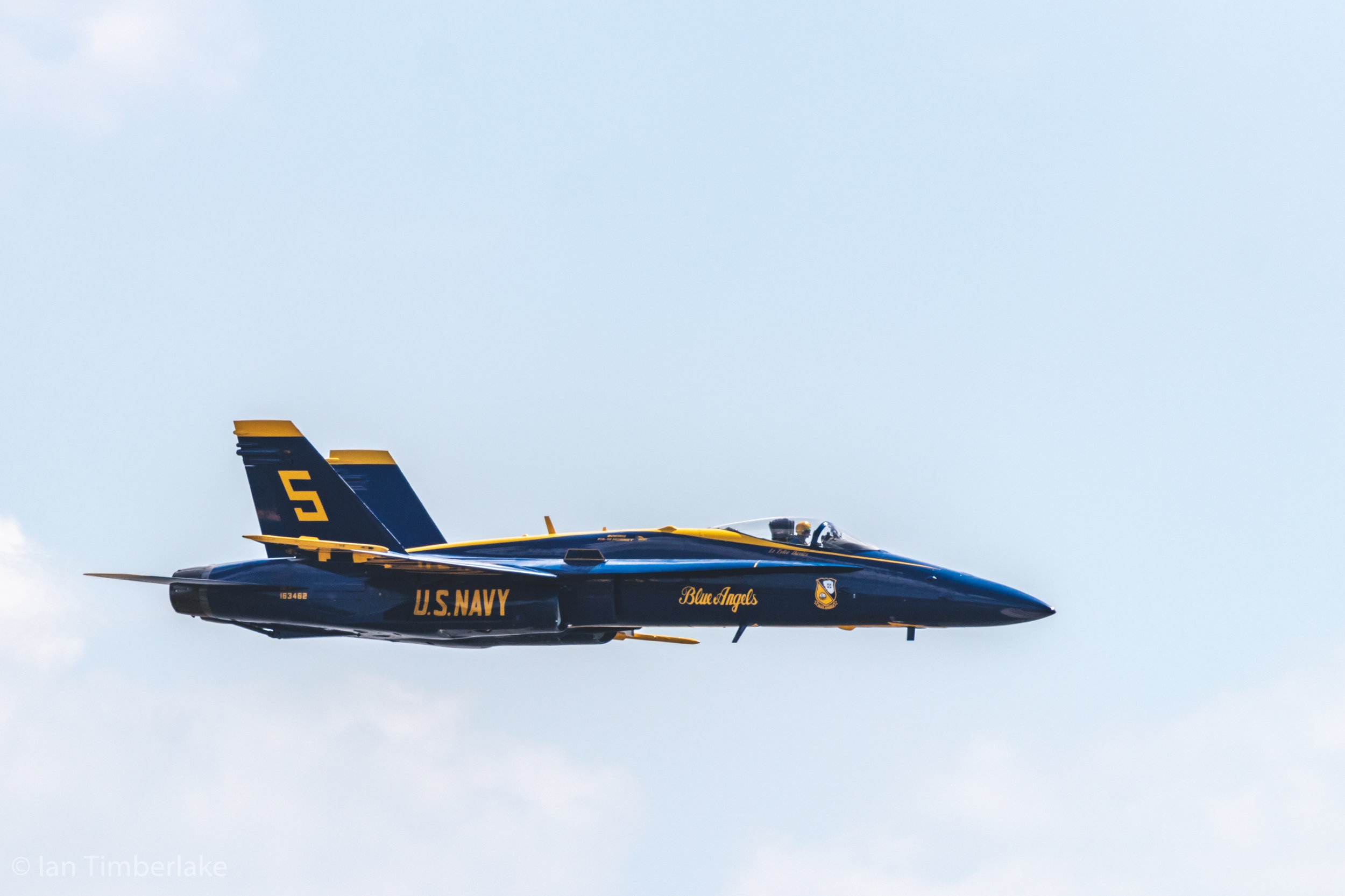 United States Navy Blue Angel #5, piloted by Navy Lieutenant Tyler Davies at the United States Naval Academy in Annapolis, Maryland. Yes, this was shot from the ground. Taken at 400mm, 1/2500th sec, f/5.6, ISO 125.