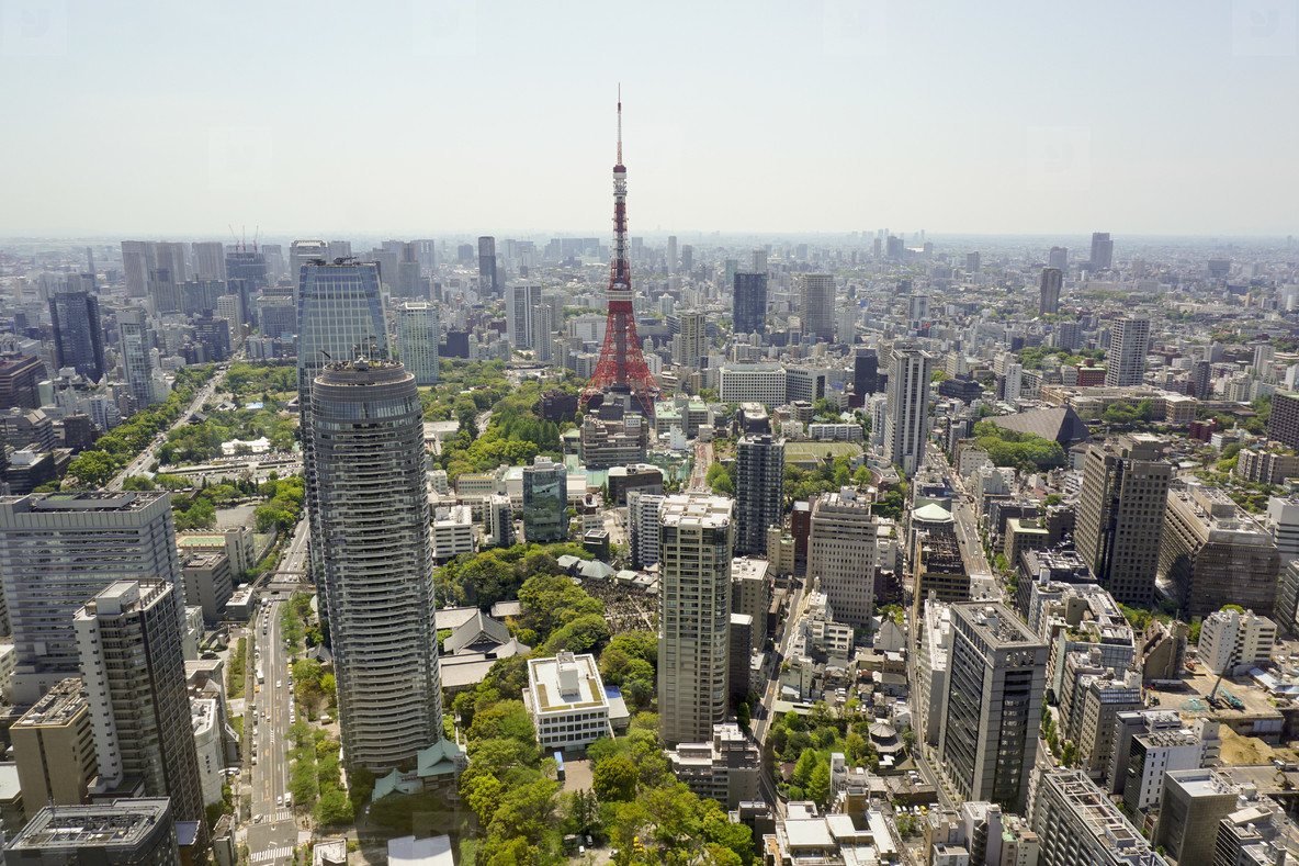 Aerial view of Tokyo Tower in city against sky on sunny day, Tokyo, Japan. Photo by Marc Volk.