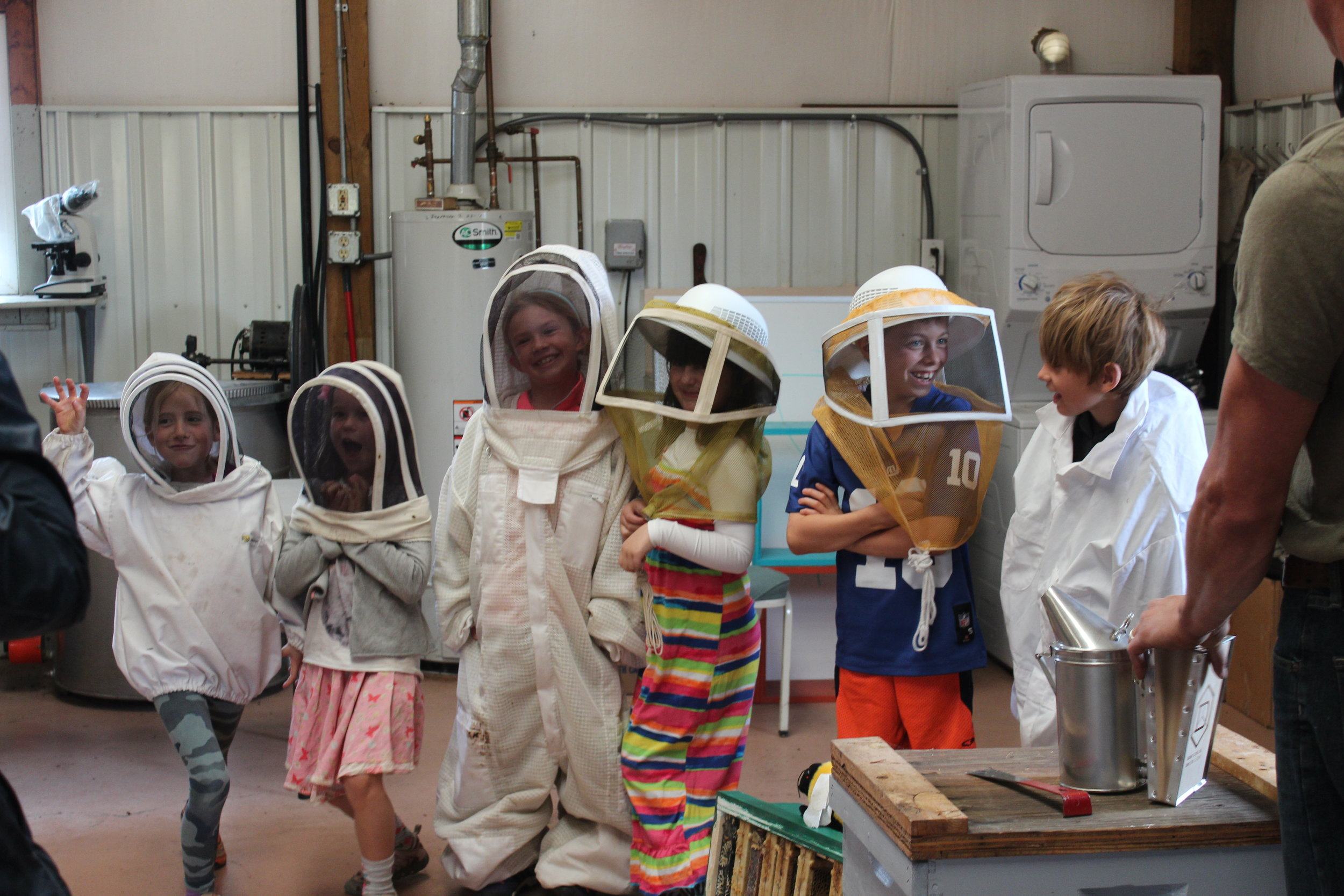 Wearing bee nets is part of the job when you're learning about one of the oldest forms of agriculture!