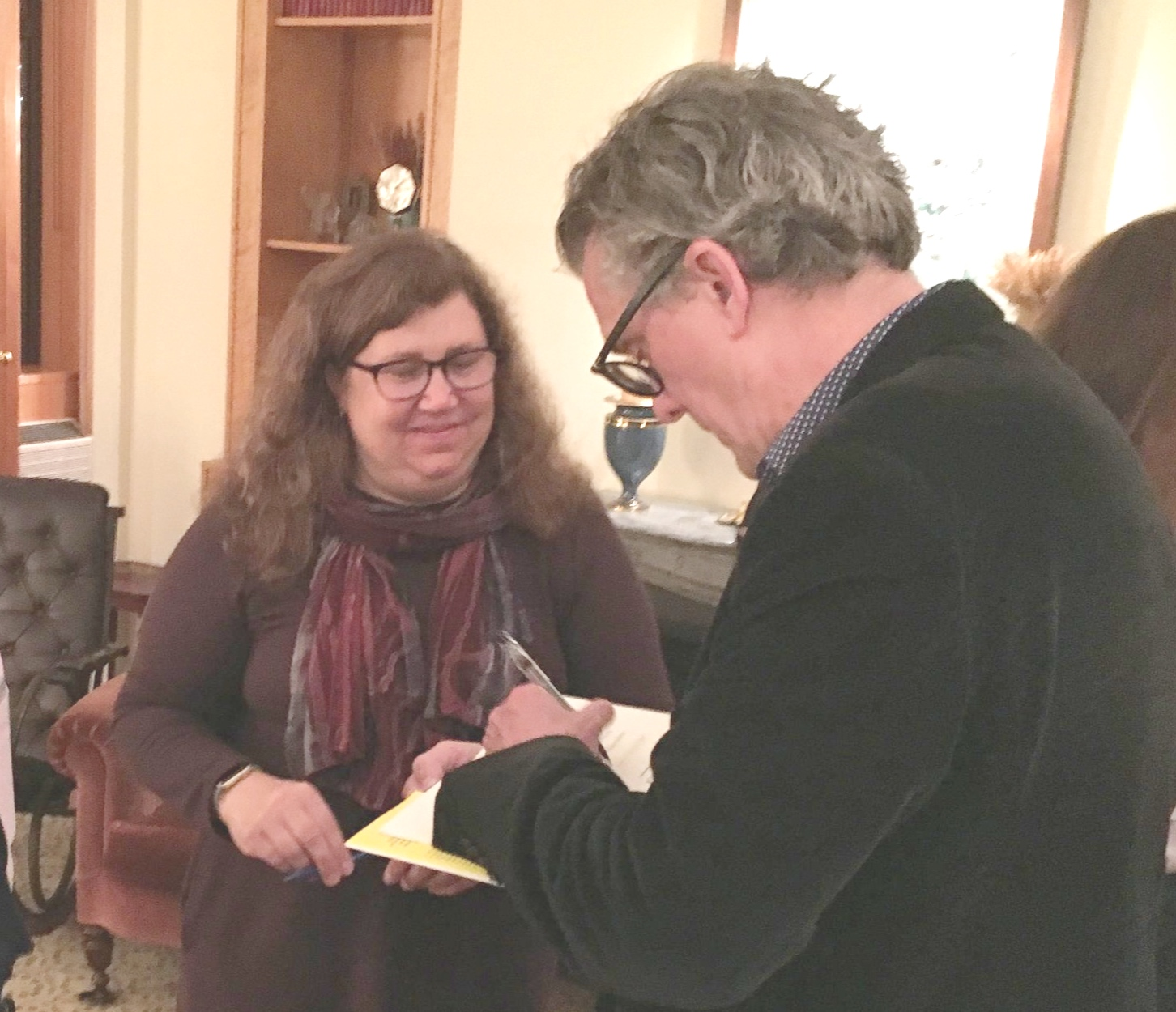 Kurt Andersen signs a copy of FANTASYLAND