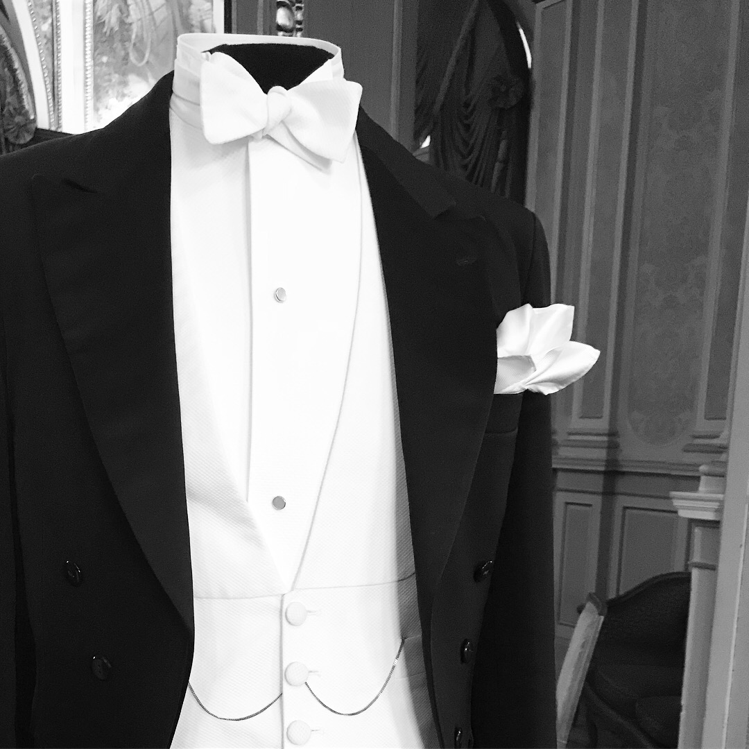 Black wool evening suit with shirt, waistcoat and bow tie in white marcella.