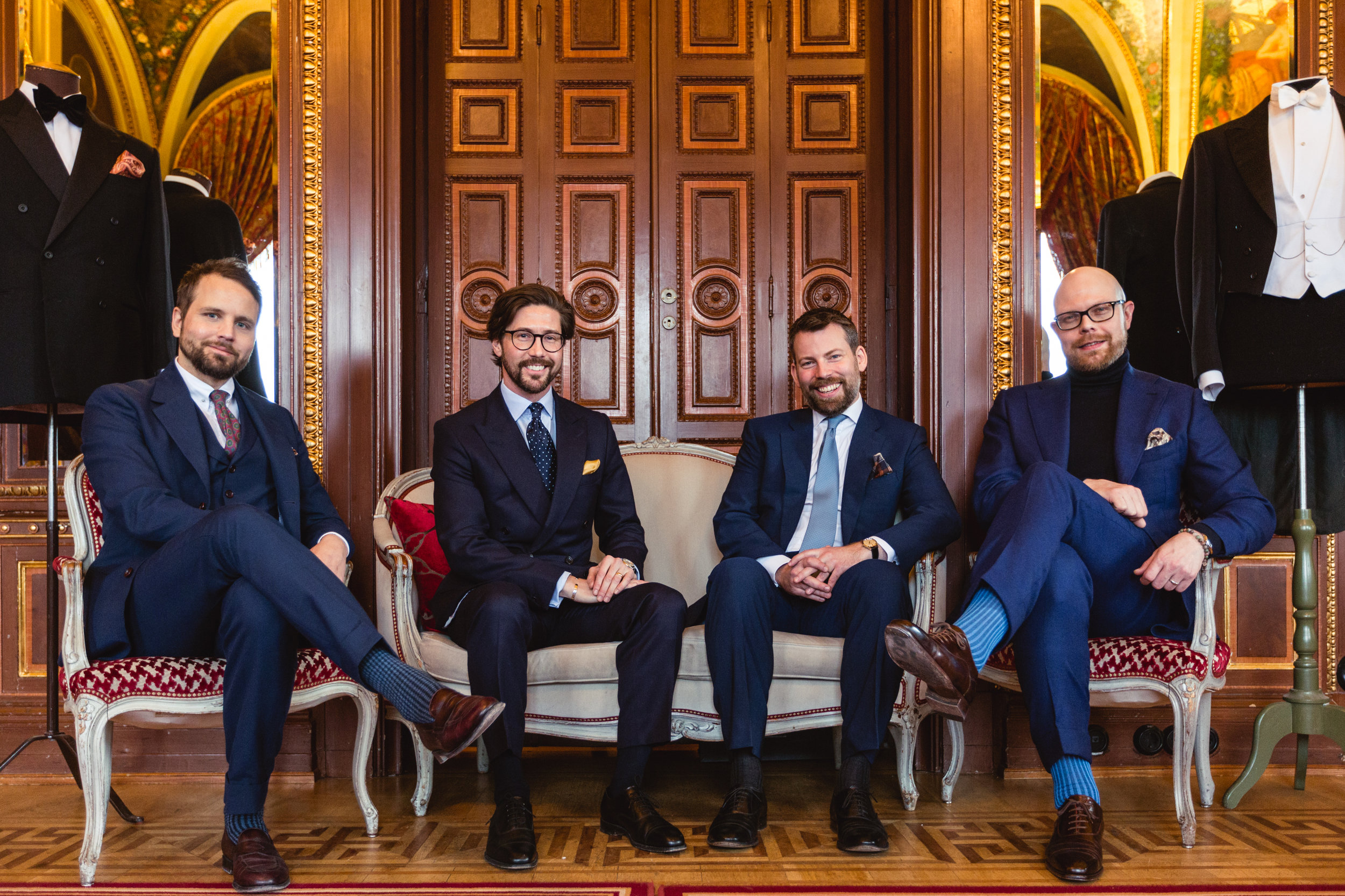 The Götrich Team in four different takes on the traditional business suit.