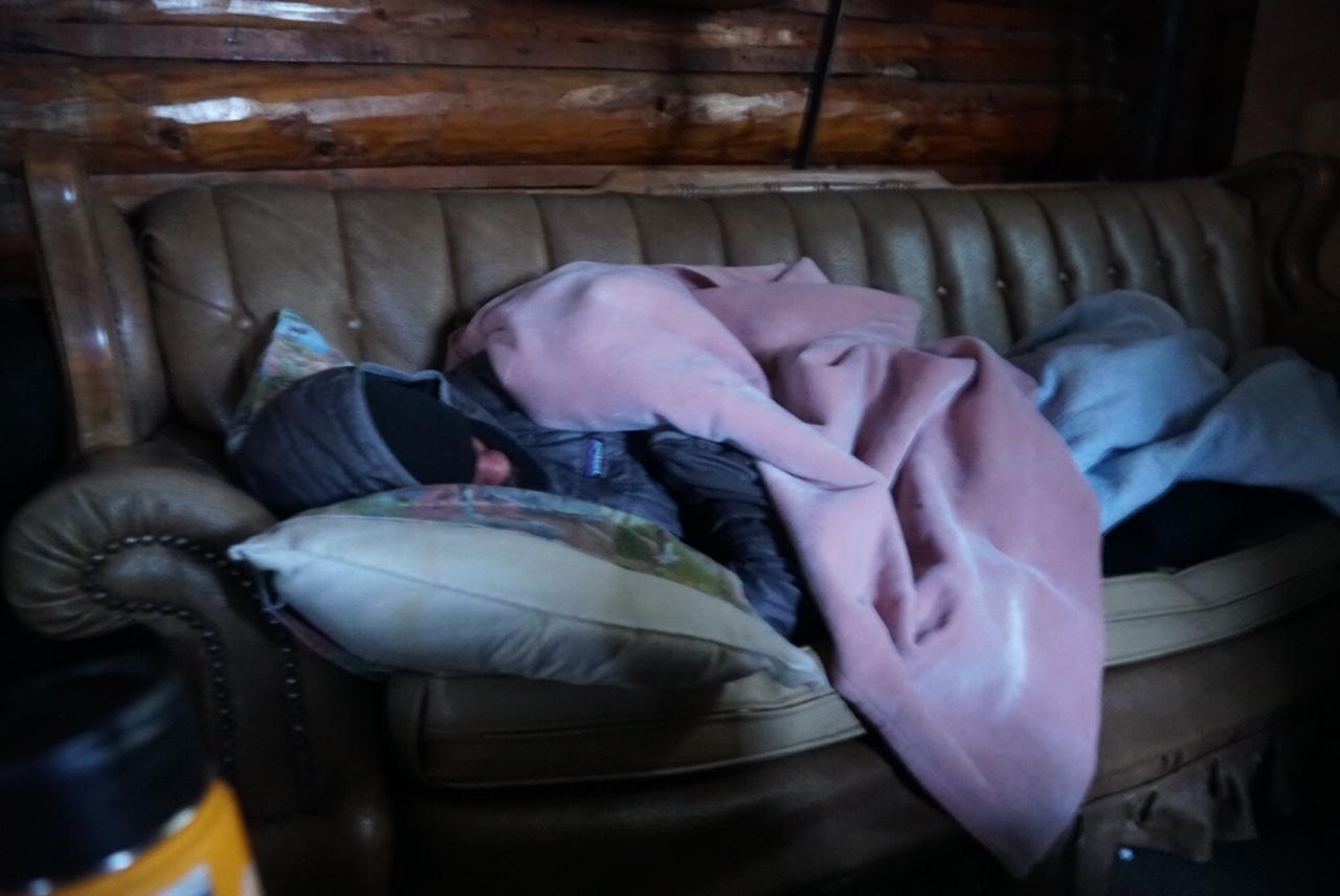 John Logar grabs some shut-eye in the Rainy Pass Lodge cabin