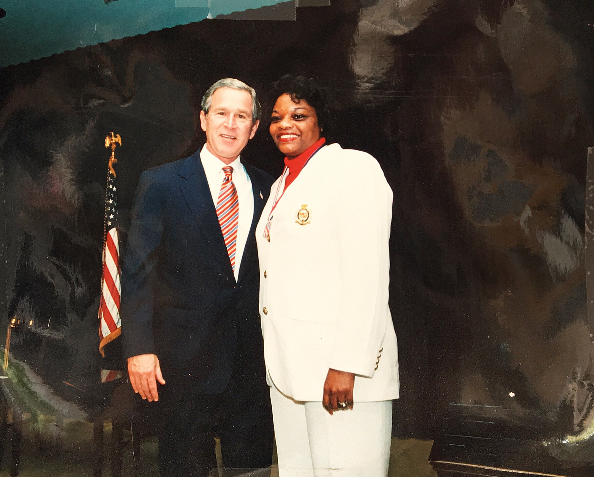 Melanie Washington with President George W. Bush, receiving Points of Light presidential community service award