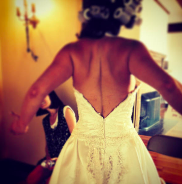 A nice shot of me on a direct booking as a commercial bride. Guess who had to be clipped into their dress because it didn't zip over her lats.