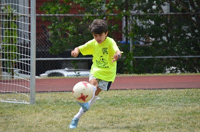 Philip showing us the proper way of kicking a soccer ball. #summer camp #soccercamp #astoriaqueens #queenssoccer