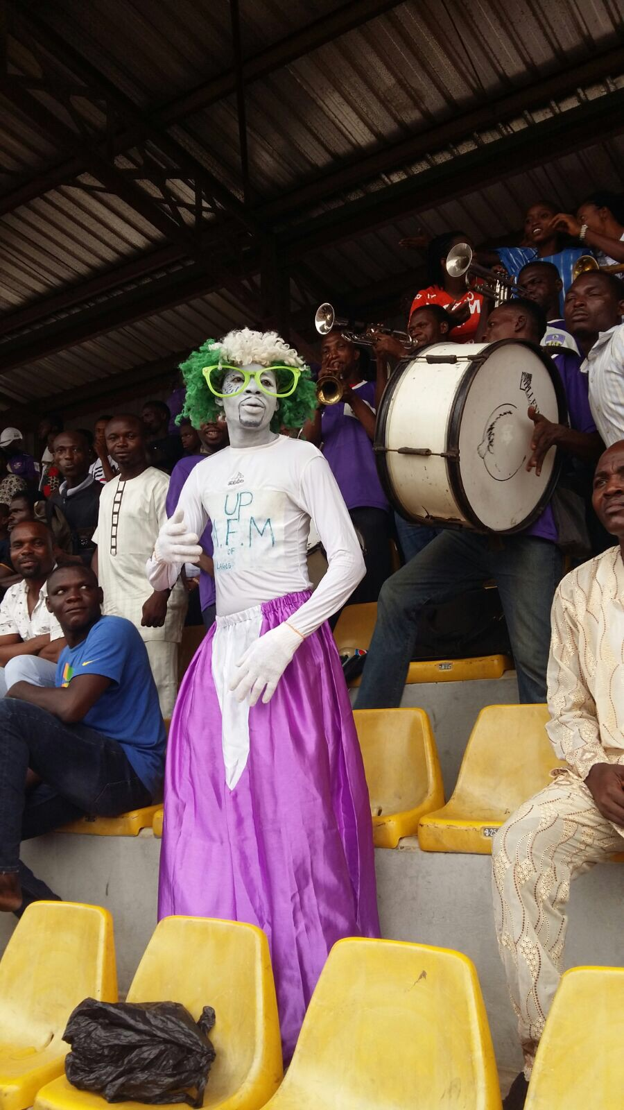 A Mountain of Fire and Miracles FC fan watches a match at Agege Stadium.  Photo by David Goldblatt.