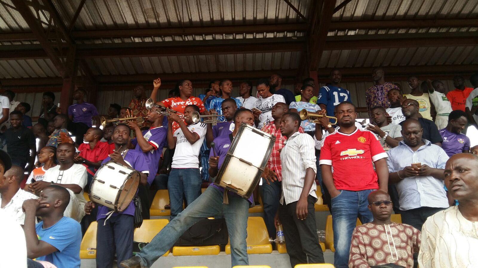 A brass band, comprised of football fans, plays in the stands at Agege Stadium.  Photo by David Goldblatt.