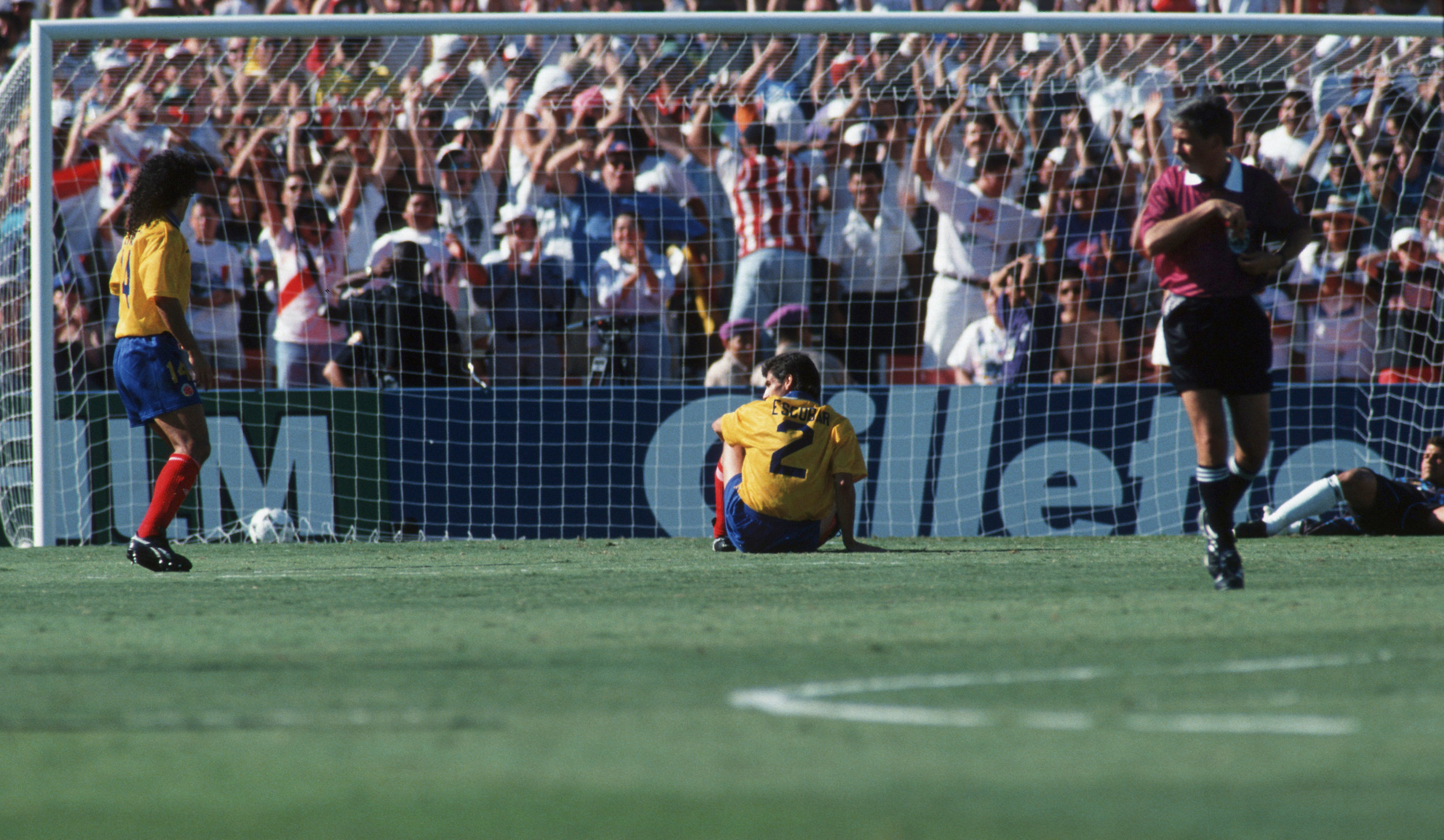 Andrés Escobar after scoring an own goal in Colombia's 1994 World Cup match against the U.S. Colombia lost the game, and Escobar was shot to death less than two weeks later by men who lost money on the match. Photo by Michael Kunkel/Bongarts/Getty Images