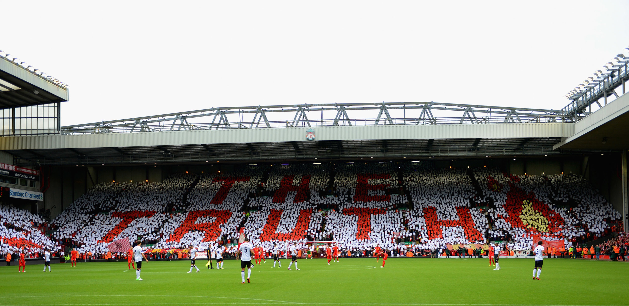 Liverpool fans hold up a mosaic tribute to the Hillsborough tragedy before a 2012 game against Manchester United. Photo by Michael Regan/Getty Images