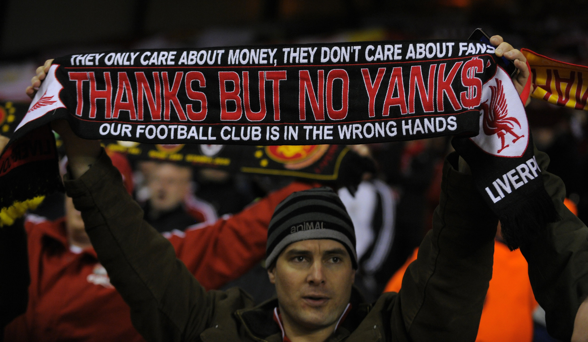 Liverpool FC fans protest the club's new American owners in 2010.  Photo by AMA/Corbis