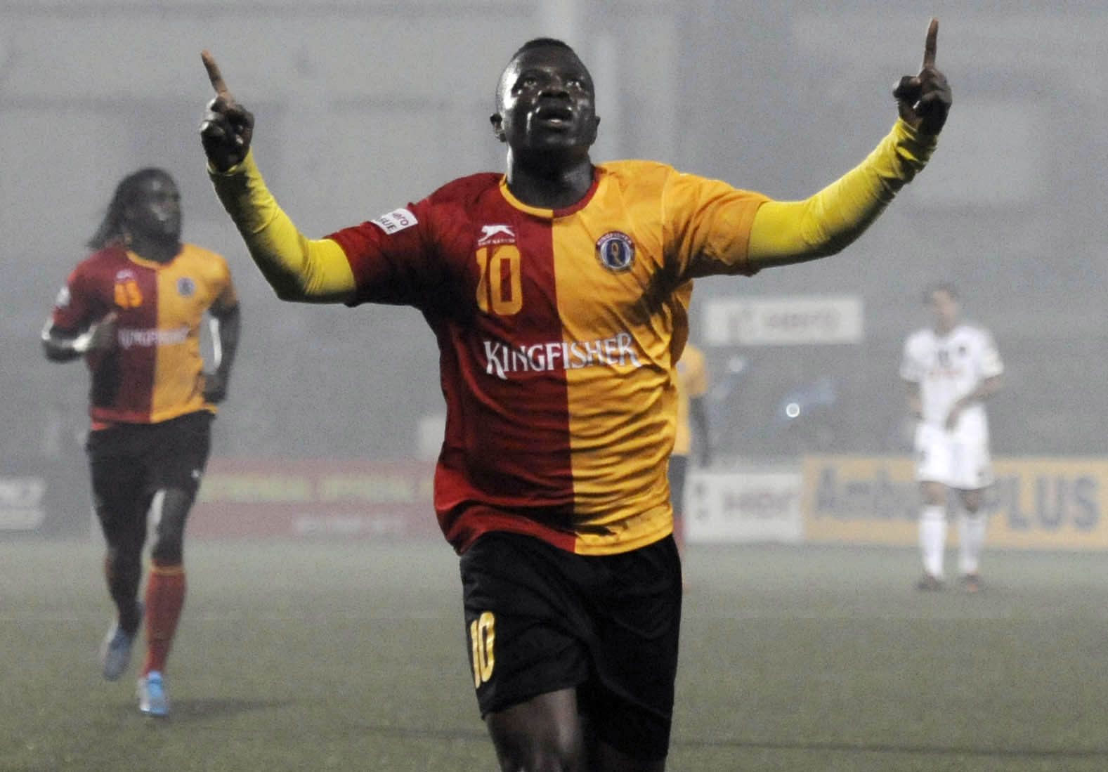 Ranti Martins of the I-League's East Bengal celebrates with teammates after scoring against Shillong Lajong FC during a match in 2016. Photo by Subhendu Ghosah/Hindustan Times via Getty Images