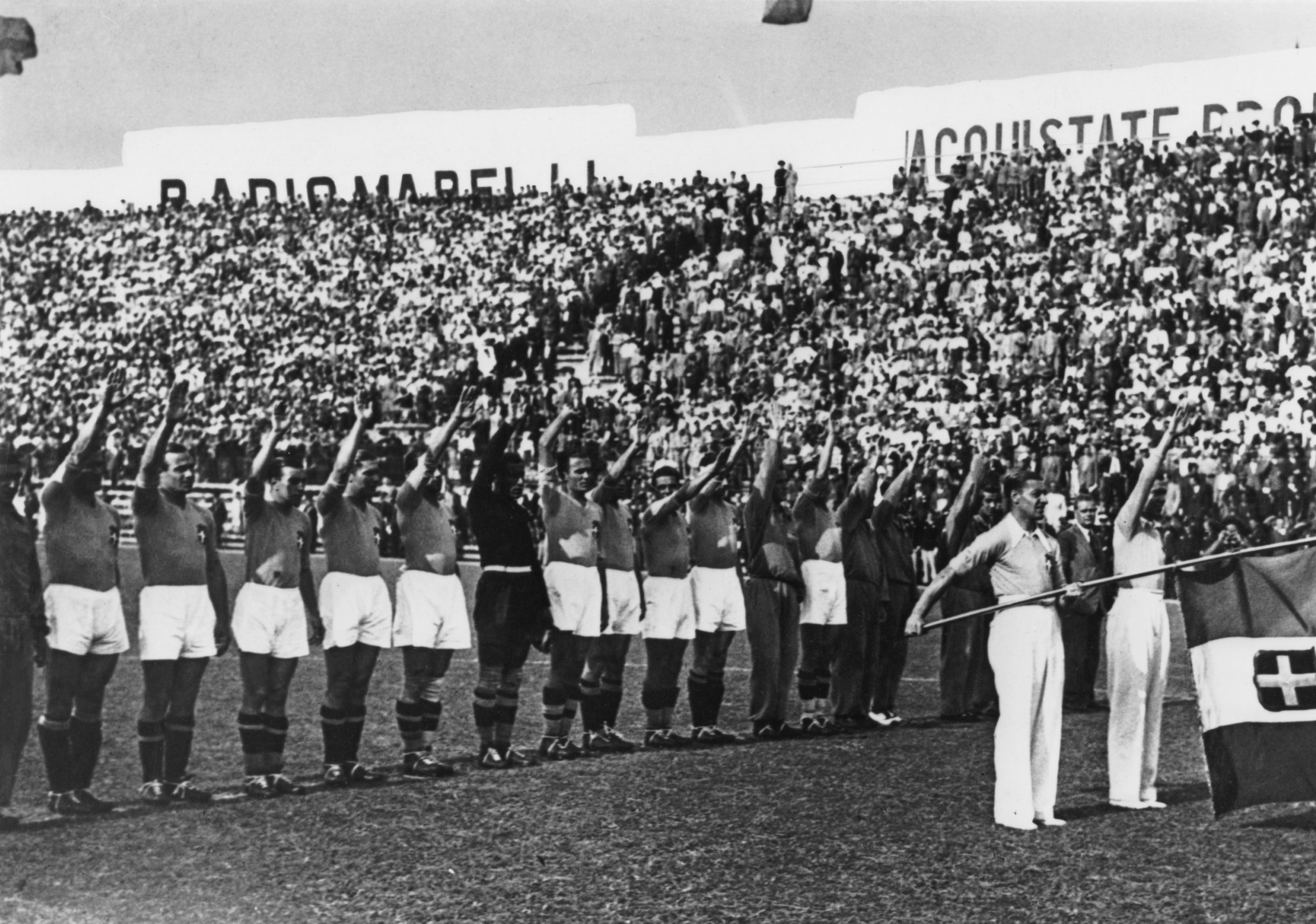 The Italian team performing the fascist salute before the 1934 World Cup Final in Rome, Italy.  Photo by Keystone/Hulton Archive/Getty Images