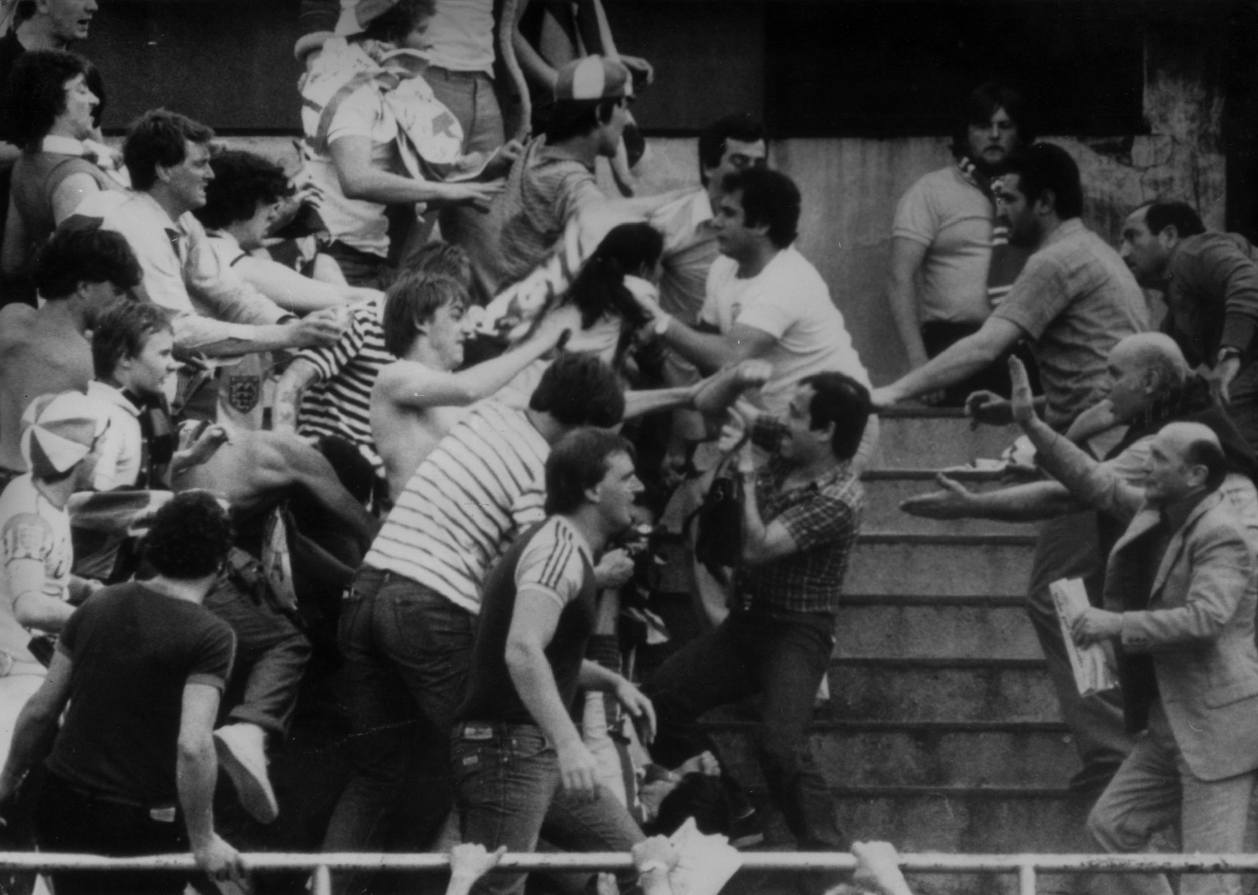 English fans fight rival supporters at a football match in Turin during a European Nations Cup Competition in 1980.  Photo by Central Press/Getty Images