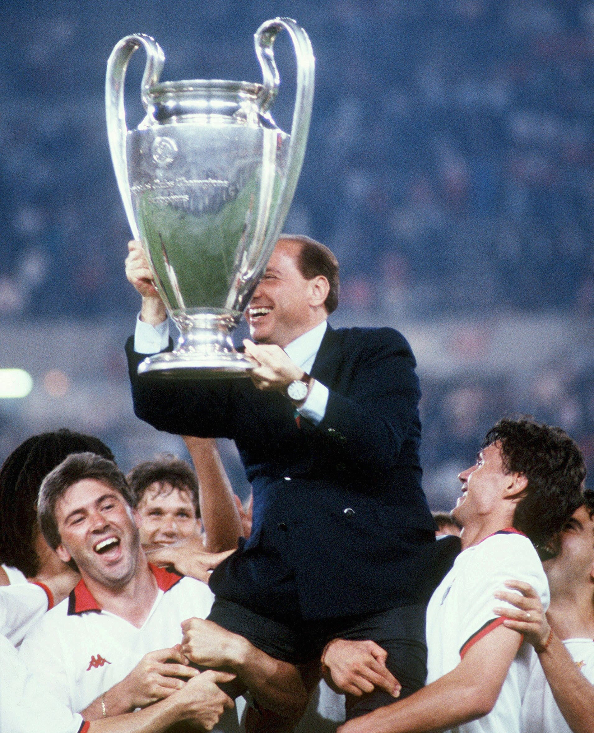 Silvio Berlusconi, former Italian Prime Minister and owner of AC Milan from 1986-2017, celebrates the team's 1994 win in the Europa League. Photo by Bongarts/Getty Images