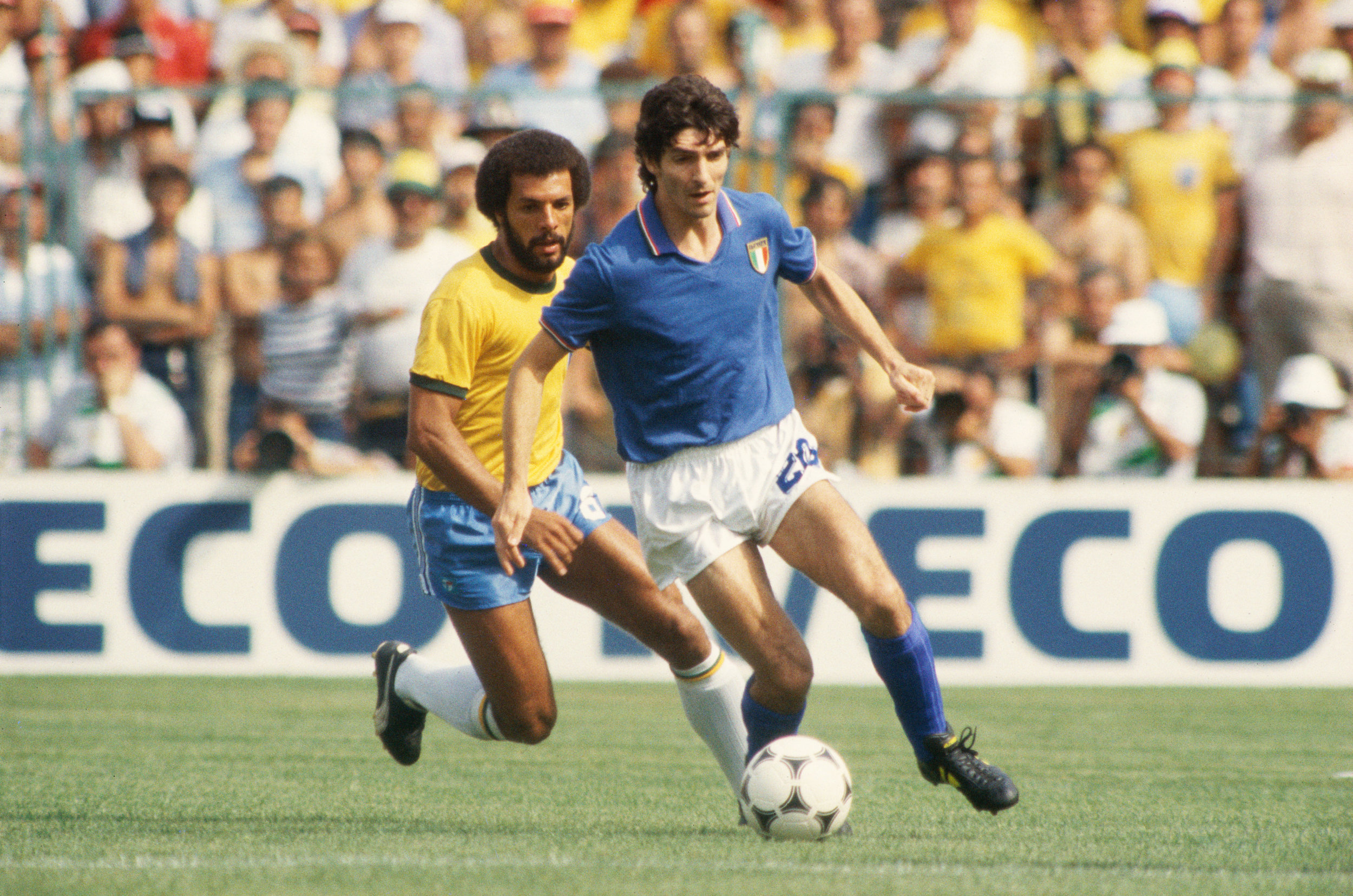Paolo Rossi shields the ball from Brazil during a 1982 World Cup match. Photo by Getty Images