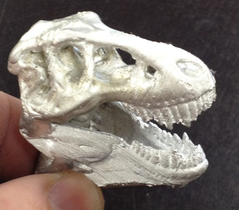 A pewter T-Rex skull. Every flaw–that is, detail–was captured faithfully.