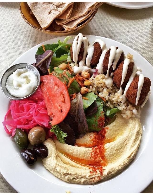 nuba - If you love Lebanese food like me (more like an obsession)you will love Nuba!Nuba focuses on local and organic ingredients and the menu is predominantly vegan, however there are halal &hormone free meats as well. As you can see their plates are beautifully made and drool worthy! As a die hard hummus fan and expert I have to say this is one of the best I have had... which is saying a lot ! They have many locations scattered throughout Vancouver including Yaletown, Mount Pleasant, Gastown, and Kitsilano.Check them out herePhoto: Falafel plate at Nuba Yaletown.