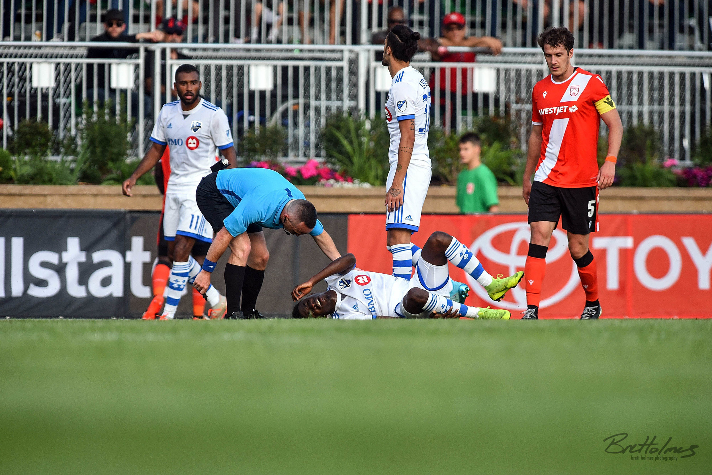 CALGARY, AB - AUGUST 14: Montreal Impact defender Clément Bayiha (27) reacts after being taken down during the first half of the second leg of a Canadian Championship semifinal match between the Montreal Impact and Cavalry FC on August 14, 2019, at ATCO Field at Spruce Meadows in Calgary, AB. (Photo by Brett Holmes/Icon Sportswire)