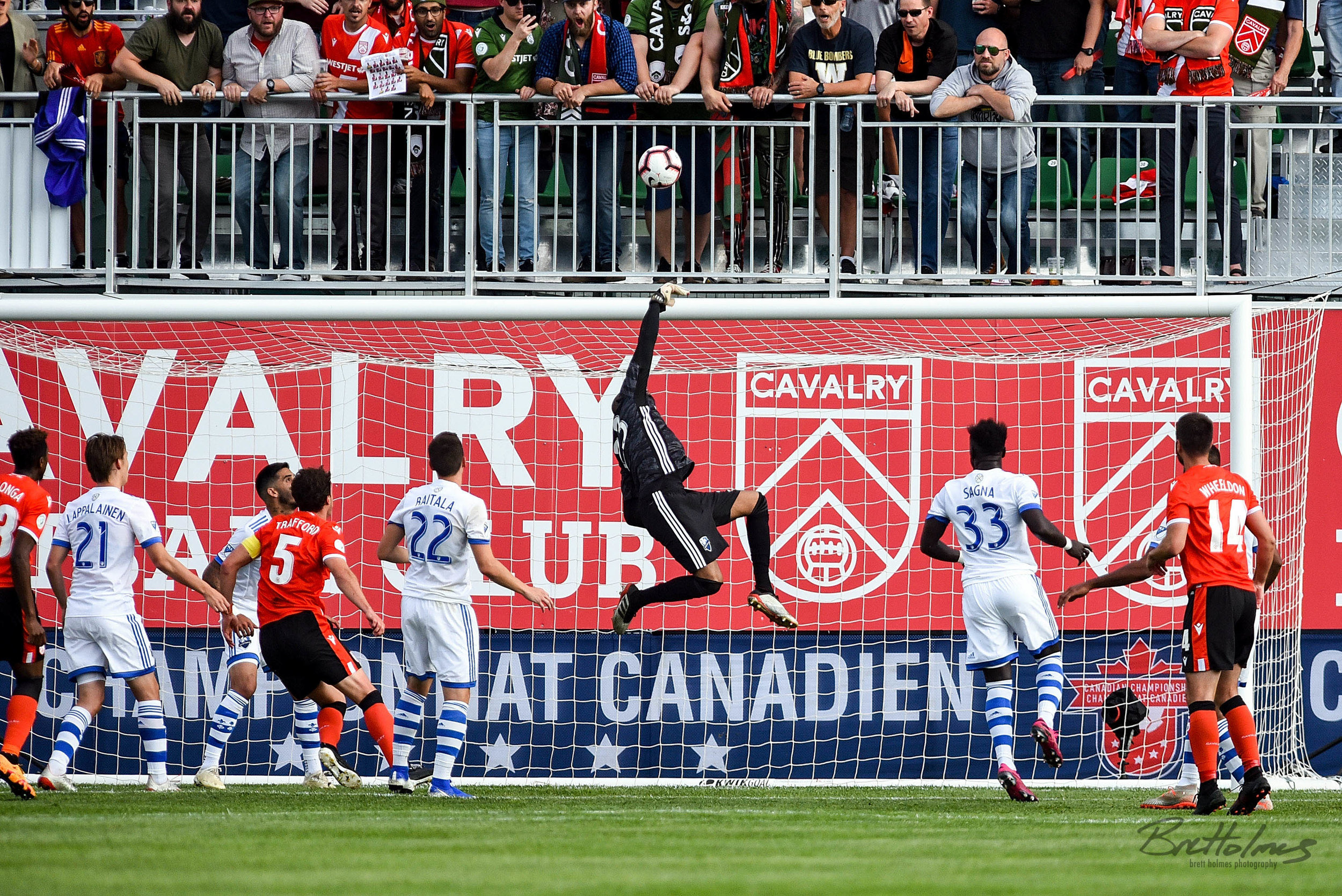 CALGARY, AB - AUGUST 14: Montreal Impact goalkeeper Clément Diop (23) makes a save during the first half of the second leg of a Canadian Championship semifinal match between the Montreal Impact and Cavalry FC on August 14, 2019, at ATCO Field at Spruce Meadows in Calgary, AB. (Photo by Brett Holmes/Icon Sportswire)