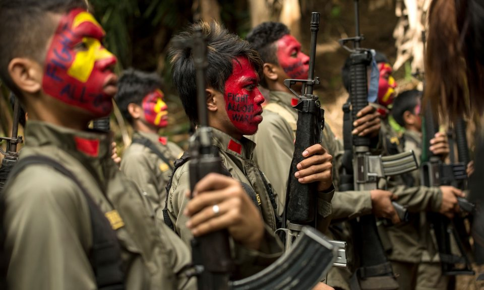 New People's Army (NPA) fighters in formation in the Sierra Madre mountain range, located east of Manila. Photo: AFP/Noel Cialis