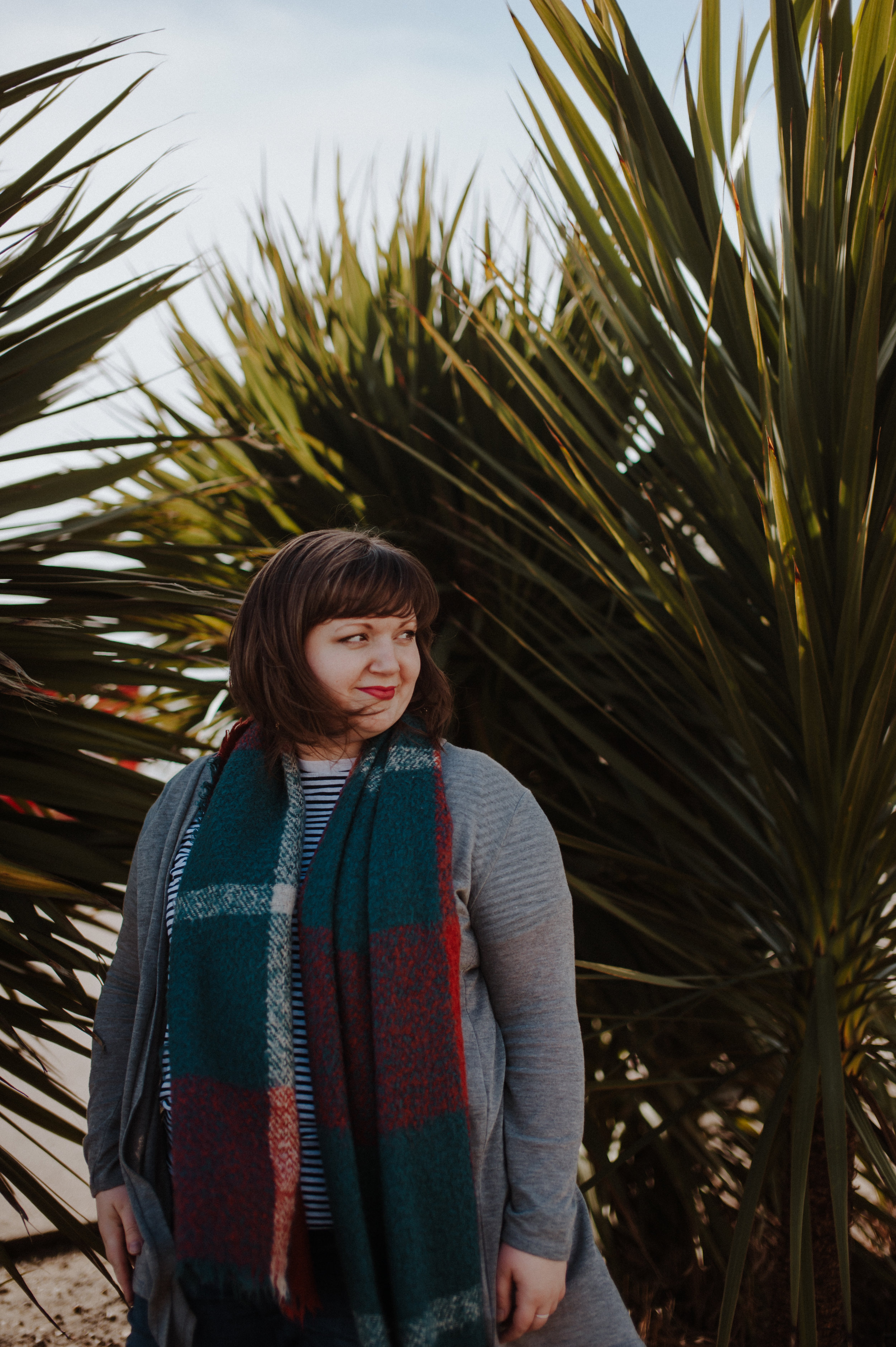 Rosie from Join The Circle in front of some ferns along Southend seafront