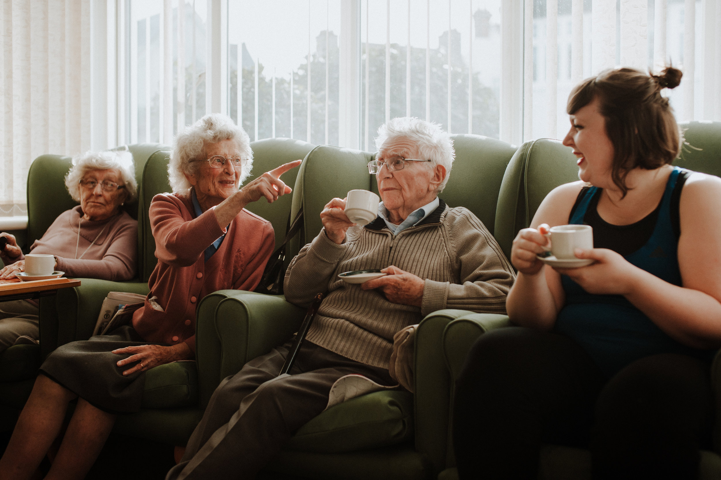 residents enjoy a joke in the living room at Brambles care home Leigh-on-Sea
