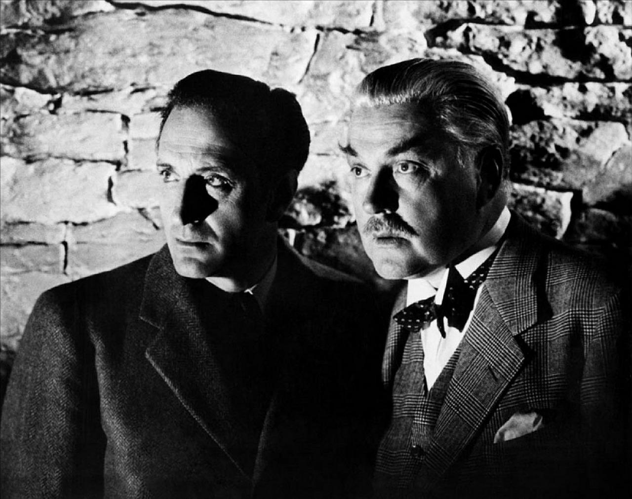 Basil Rathbone as Sherlock Holmes and Nigel Bruce as Dr. Watson